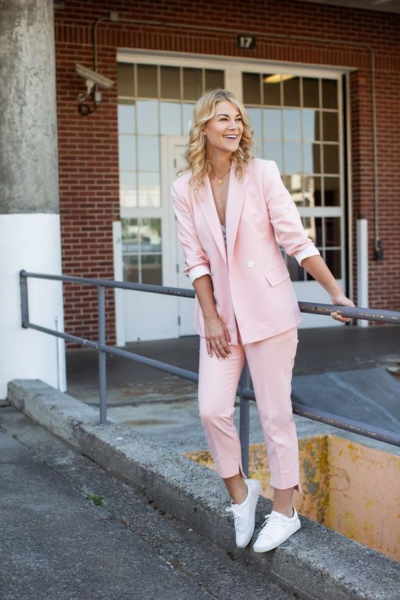 a pink pantsuit, a neutral top, white sneakers for a bright summer look