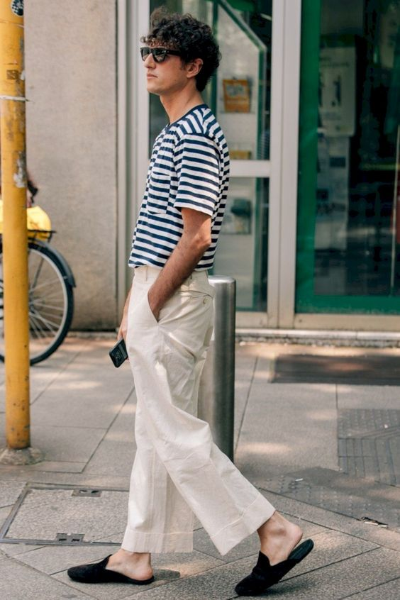 a striped tee, wideleg neutral pants and black slipper mules for a comfy casual outfit