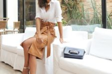 15 a white button down, a camel high waisted midi with a slit and a sash plus metallic heels