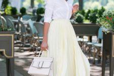 15 a white button down, a pale yelow asymmetrical pleated midi, white heels and a white bag