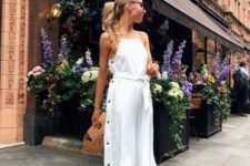 15 a white dress with a halter neckline, black buttons on the side, white slingbacks and a wooden bag