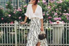 15 a white oversized button down, a printed asymmetrical midi skirt, white sneakers and a brown printed bag