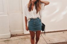 15 an oversized short-sleeved white button down, a deconstructed denim skirt, white sneakers and a black bag