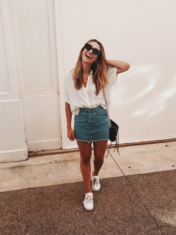 an oversized short sleeved white button down, a deconstructed denim skirt, white sneakers and a black bag