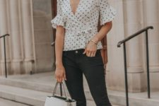 15 black skinnies, a black and white polka dot tie shirt with ruffled sleeves, white heels and a white bag