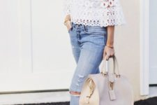 15 light blue ripped jeans, a white crochet blouse with bell sleeves and a high neckline, burgundy shoes and a neutral bag