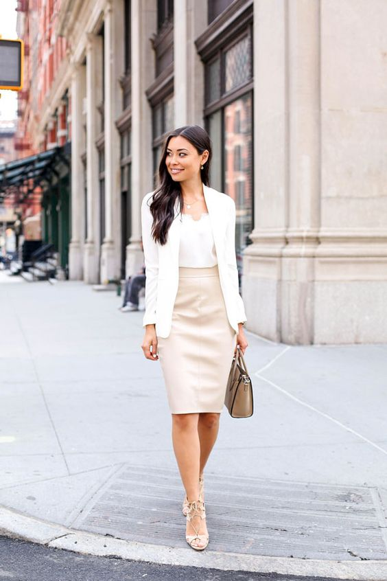 a formal work outfit with a white top, a blush pencil knee skirt, nude strappy heels and a white blazer in case it gets chilly