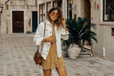 16 a yellow mini dress with a floral print, a white denim jacket, a brown bag and white platform shoes