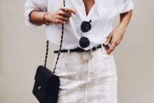 16 an oversized white button down, a snake print mini, a blakc belt and a small bag for summer