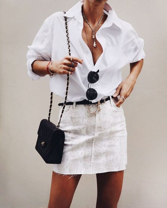 an oversized white button down, a snake print mini, a blakc belt and a small bag for summer