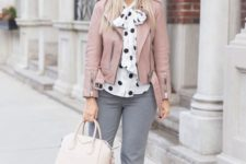 16 grey pants, a white and black pola dot blouse, a pink leather jacket, a grey beret, nude heels and a white bag