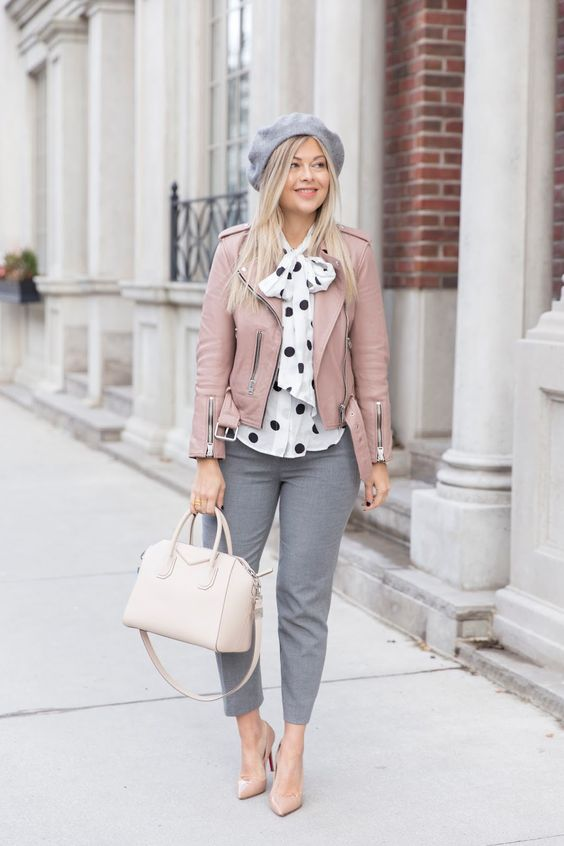 grey pants, a white and black pola dot blouse, a pink leather jacket, a grey beret, nude heels and a white bag
