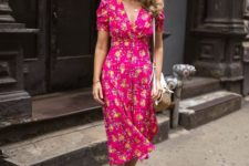 16 pair a bright pink floral fitting dress and white slingbacks to achieve a chic retro look