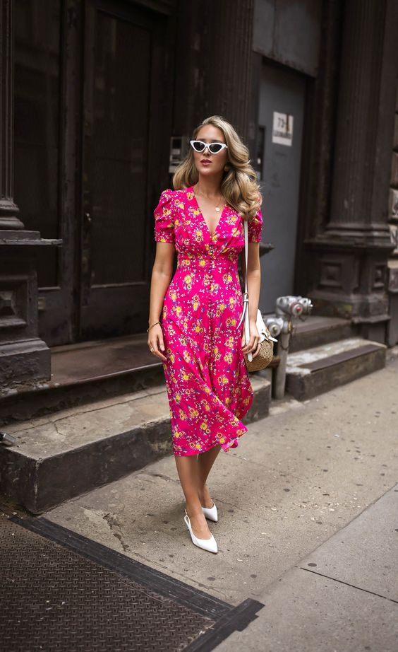 pair a bright pink floral fitting dress and white slingbacks to achieve a chic retro look