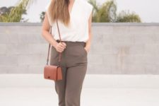 16 taupe pants, a white sleeveless top, blush sneakers and a camel bag for a summer work look