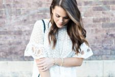 16 white skinnies, a white crochet lace blouse with short sleeves and a small black bag