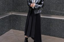 With beige turtleneck, black leather jacket and black ankle boots
