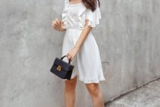 With black bag and beige lace up shoes