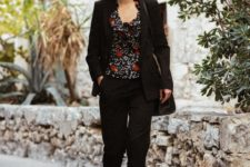 With black blazer, black crop pants, bag and red boots