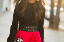 With black blouse, red wrapped skirt and printed clutch