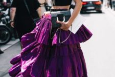 With black crop top and clutch
