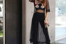 With black flare pants, lace up heels and bag
