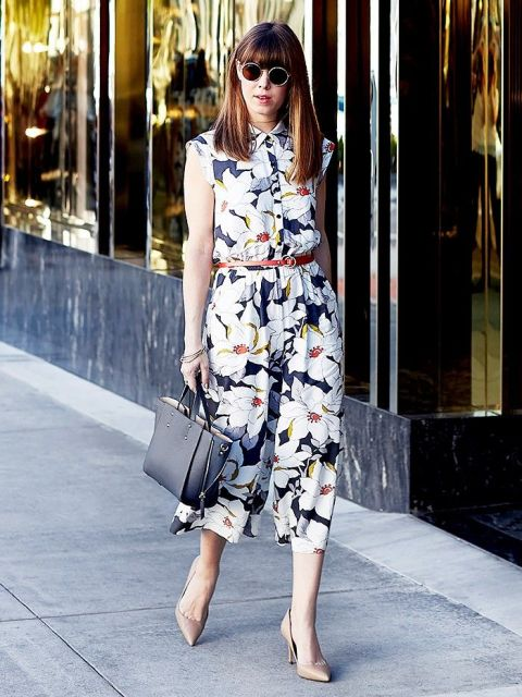 With black leather bag, brown belt and beige pumps