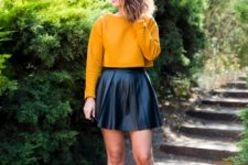 With black leather mini skirt and black ankle boots