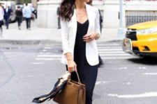 With black midi dress, brown leather bag and beige sandals