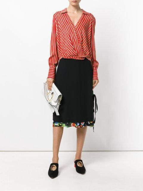 With black midi skirt, white clutch and black flat shoes