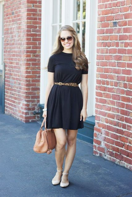 With black mini dress, beige leather bag and ankle strap flats