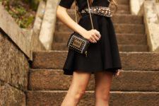 With black mini dress, mini bag and high heels