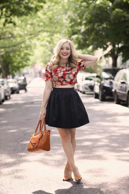 With black mini skirt, brown bag and heels