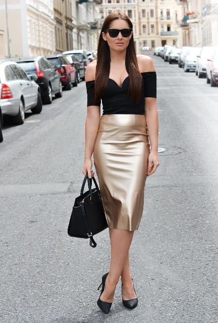 With black off the shoulder blouse, black bag and black pumps
