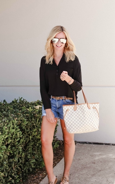 With black shirt, denim shorts, printed tote and sandals