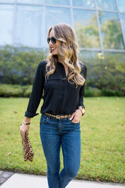With black shirt, leopard clutch and jeans