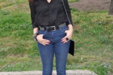 With black shirt, skinny jeans, red shoes and chain strap bag