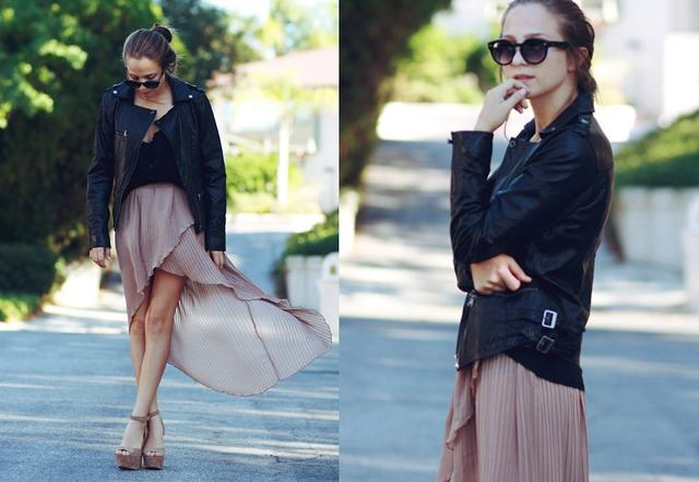 With black top, black leather jacket and platform shoes