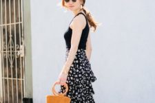 With black top, brown bag and platform shoes