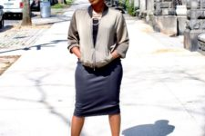 With black top, midi skirt and black cutout boots