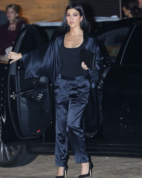 With black top, silk jacket, clutch and black pumps