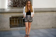 With black top, white blazer, chain strap bag and black flat shoes