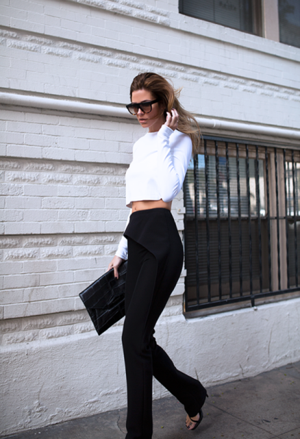 With black trousers, high heels and black clutch