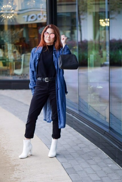 With black turtleneck, black pants, white boots, denim coat and black bag