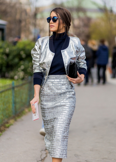 With black turtleneck, metallic blazer and black clutch