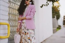 With blouse, pale pink blazer, unique bag and bow shoes