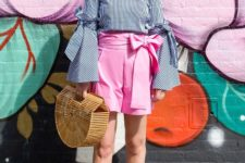 With blouse, pink shorts, straw bag and beige shoes