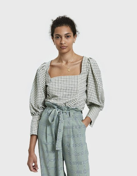 With checked belted trousers