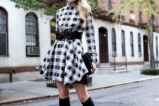 With checked dress, black clutch and black shoes