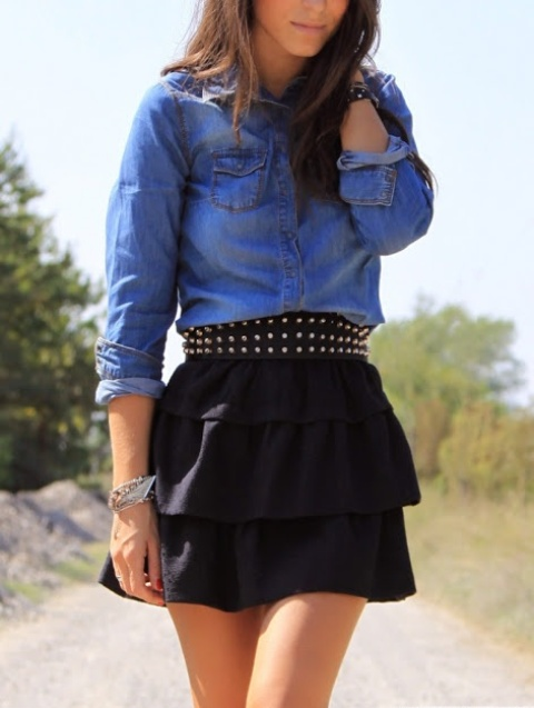 With denim shirt and black skirt
